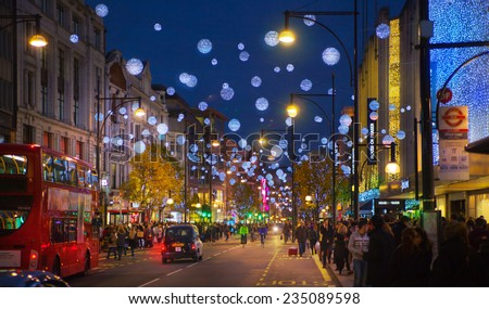 LONDON, UK - NOVEMBER 30, 2014: Black Friday weekend in London the first sale before Christmas. Regent street decorated with Christmas lights. Street was closed for traffic and open for pedestrians - stock photo