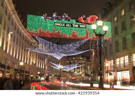 London, UK - November 12, 2011: Christmas lights display along Regent Street ,with blurred light trails from passing vehicles, during the festive season. - stock photo