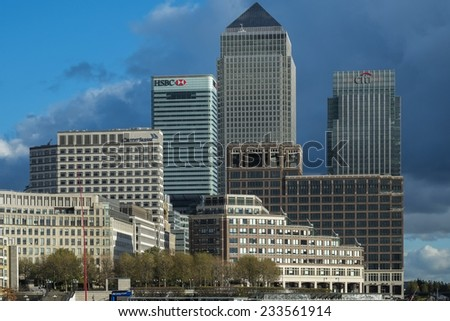 LONDON, UK - NOVEMBER 7 2014 - Mid Afternoon view of Canary Wharf London taken from the opposite side of the river Thames - stock photo