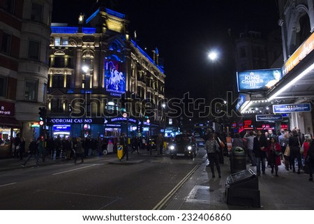 LONDON, UK - NOVEMBER 15: people enjoy the nightlife in Leicester Sq in London on November 15, 2014. Leicester Sq is the prime location in London for cinemas and world leading film premiers.  - stock photo