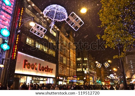 LONDON, UK-NOVEMBER 16: Shoppers are encouraged to London's West End to do their shopping, by the Christmas lights and department store's decorations along Oxford Street.November 16, 2012 in London UK - stock photo
