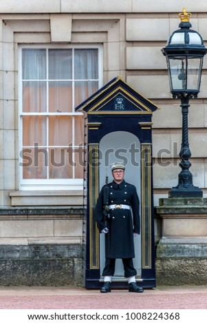 LONDON, UK - NOVEMBER 29, 2017: Soldier on guard at Buckingham Palace, part of contingents of infantry and cavalry soldiers charged with guarding the official royal residences.