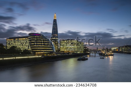 LONDON, UK November 8th 2014 - A long exposure shot of The Shard and City Hall at Night - stock photo