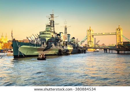 LONDON, UK - NOVEMBER 11TH 2015: HMS Belfast ship originally a Royal Navy light cruiser is now permanently moored on the River Thames as a museum ship vintage, photo taken  on 11th NOVEMBER 2015. - stock photo