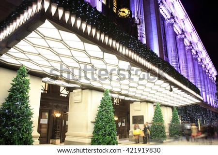 London, UK - November 10, 2011: The Christmas tree decorations outside Selfridges at night, in Oxford Street during the festive season - stock photo