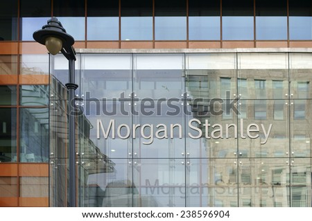 LONDON, UK - NOVEMBER 29: The facade of modern bank building from Morgan Stanley with reflections and a nostalgic lantern on November 29, 2014 in London / Morgan Stanley         - stock photo
