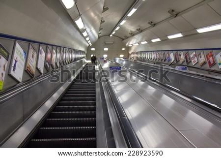 LONDON, UK - OCTOBER 18: Empty escalator deep in the London Underground, UK, on October 18, 2014.  - stock photo