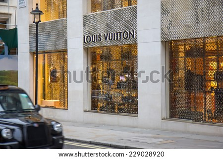LONDON, UK -  OCTOBER, 17, 2014: Founded in 1854, Louis Vuitton today has 19,000 employees in more than 65 countries around the world. New Bond street, London. - stock photo