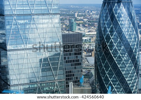 LONDON, UK - OCTOBER 14, 2015;Gherkin building  Modern office blocks City of London, business and banking aria.