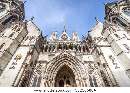 LONDON, UK - OCTOBER 25, 2015: Known as The Law Courts, The Royal Courts of Justice houses the High Court and Court of Appeal of England and Wales. Many high profile cases have been carried out here. - stock photo