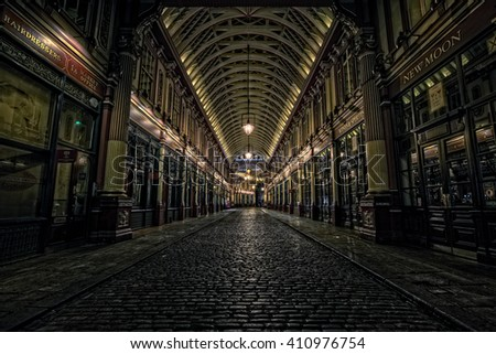 LONDON, UK - OCTOBER 4, 2014: Leadenhall Market in the City of London, empty of people on a Saturday evening. This was used as a location for the first Harry Potter movie.
