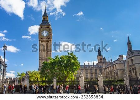 LONDON, UK - OCTOBER, 2014:  London England street scene at landmark Big Ben and Westminster Palace.   - stock photo