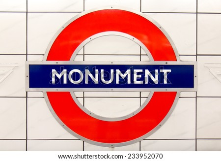 LONDON, UK - OCTOBER 17, 2014: Metro station sign Monument on the District and Circle line in London, UK, October 17, 2014.  - stock photo