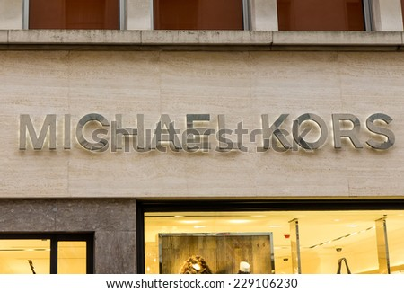 LONDON, UK - OCTOBER, 17, 2014: Michael Kors is a world-renowned, award-winning designer of luxury accessories and ready-to-wear. New Bond street, London. - stock photo