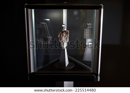 LONDON, UK - OCTOBER 22ND 2014: A fragment of Moon rock on display in the Science Museum in London on 22nd October 2014. - stock photo