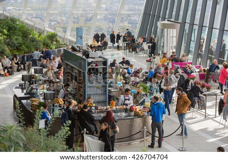 LONDON, UK - OCTOBER 14, 2015 - People in the Sky Garden relaxing, talking and having a snack