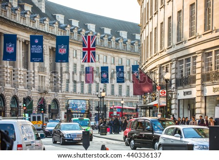 LONDON, UK - OCTOBER 4, 2015: Piccadilly circus with lot of walking people, pedestrians and public transport, cars, taxis on the road.