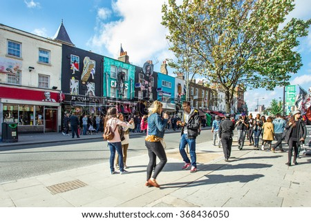 LONDON, UK - OCTOBER 10, 2014: Pictured here is a street view of historic Camden Town at the Stables  with visitors visible.   - stock photo