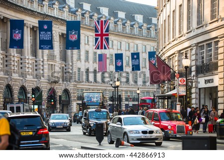 LONDON, UK - OCTOBER 4, 2015: Regent street with lots of walking people, pedestrians and public transport, cars, taxis on the road.