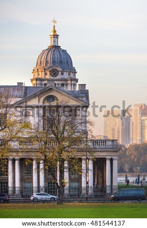 LONDON, UK - OCTOBER 31, 2015: Royal chapel, Painted hall and classic colonnade in the Greenwich park. View at sunset