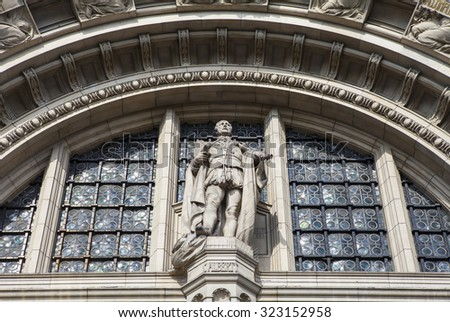 LONDON, UK - OCTOBER 1ST 2015: A statue of Prince Albert on the exterior of the historic Victoria and Albert Museum in London, on 1st October 2015. - stock photo