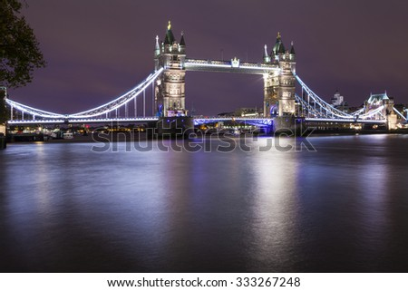 LONDON, UK - OCTOBER 29TH 2015: A magnificent night-time view of Tower Bridge and the River Thames in London, on 29th October 2015.