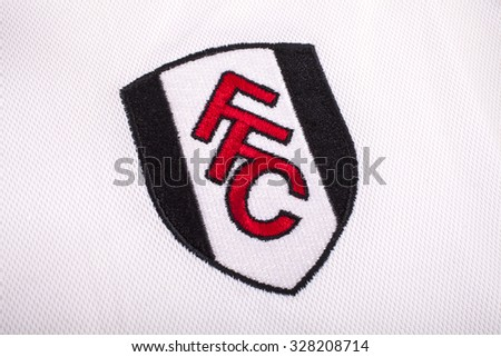 LONDON, UK - OCTOBER 15TH 2015: The club crest on a Fulham FC shirt, on 15th October 2015. - stock photo