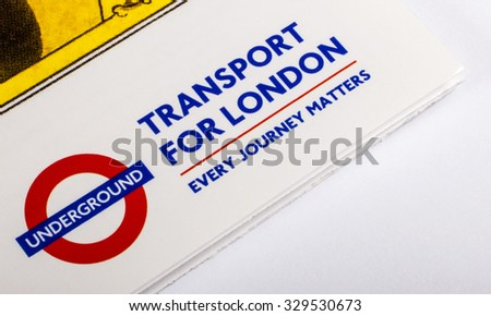 LONDON, UK - OCTOBER 19TH 2015: The London Underground and GTransport for London logos on a London Underground Map Leaflet, on 19th October 2015.