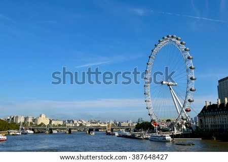 London, UK - October 7, 2012: The London Eye is a giant Ferris wheel on the South Bank of the River Thames in London.
