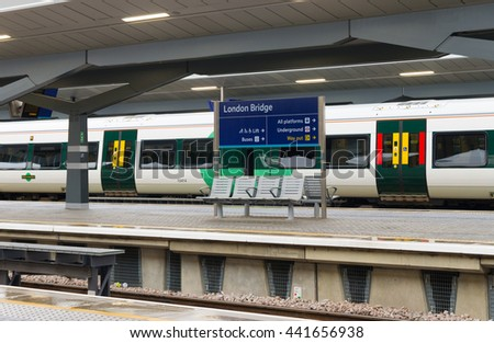 LONDON, UK - OCTOBER 21, 2015: Trains at London Bridge station. In terms of passenger arrivals and departures it is the 4th station in the United Kingdom, handling over 54 million customers a year. - stock photo