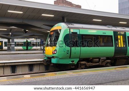 LONDON, UK - OCTOBER 21, 2015: Trains at London Bridge station. In terms of passenger arrivals and departures it is the 4th station in the United Kingdom, handling over 54 million customers a year.