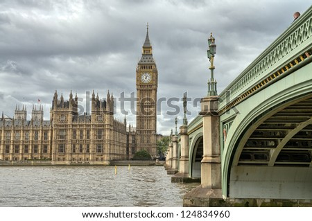 London, UK - Palace of Westminster (Houses of Parliament) with Big Ben clock tower and Westminster bridge over Thames river. - stock photo