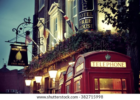LONDON, UK - SEP 27: London Street view with telephone box on September 27, 2013 in London, UK. London is the world's most visited city and the capital of UK. - stock photo