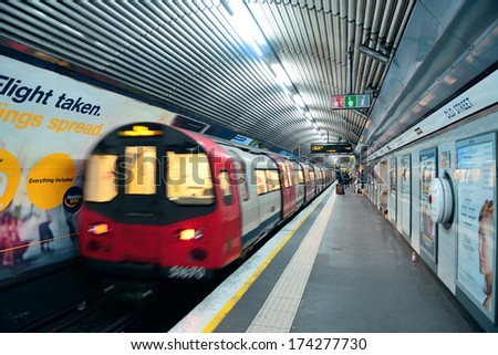 LONDON, UK - SEP 27: London Underground station interior on September 27, 2013 in London, UK. The system serves 270 stations, 402 kilometers of track with operation history of 150 years - stock photo