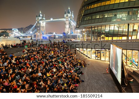 LONDON, UK - SEP 27: outdoor movie event with audience on September 27, 2013 in London, UK. London is the world's most visited city and the capital of UK. - stock photo