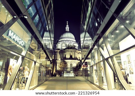 LONDON, UK - SEP 27: St Pauls Cathedral at night with glass reflections on September 27, 2013 in London, UK. London is the world's most visited city and the capital of UK. - stock photo