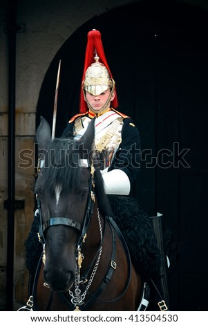 LONDON, UK - SEP 27: Trooper of the Blues and Royals on horse at the horse guard parade on September 27, 2013 in London, UK. Blues and Royals is one of two most senior regiments of the British Army - stock photo