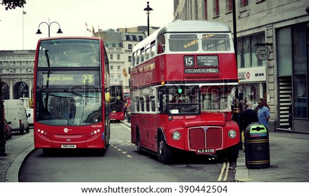 LONDON, UK - SEP 27: Vintage red bus in street on September 27, 2013 in London, UK. London is the world's most visited city and the capital of UK. - stock photo