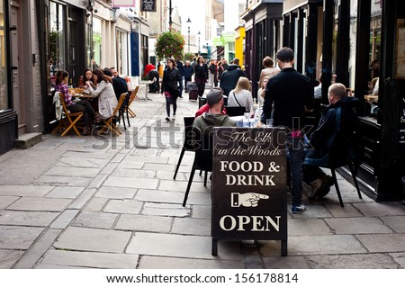 LONDON, UK - SEPT 29: people enjoy outdoor dining at the Angel in London on September 29, 2013. The district of Angel has one of the highest densities of bars and restaurants in central London. - stock photo