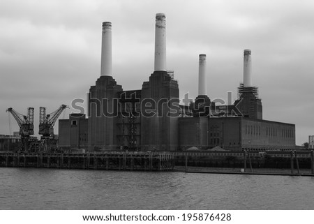 LONDON, UK - SEPTEMBER 29, 2013: Battersea Power Station during the day in black from across the River Thames - stock photo