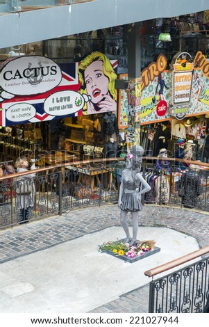 LONDON, UK - SEPTEMBER 17: Bronze statue of late singer Amy Winehouse in Camden Town. It was unveiled on what would have been her 31st birthday, 3 years after her death. September 17, 2014 in London. - stock photo