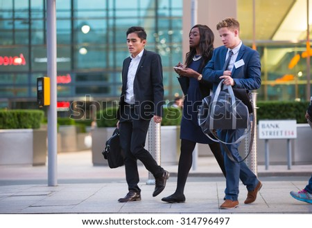 LONDON, UK - 7 SEPTEMBER, 2015: Canary Wharf business life. Business people going home after working day.