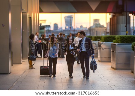 LONDON, UK - 7 SEPTEMBER, 2015: Canary Wharf business life. Group of business people going home after working day.