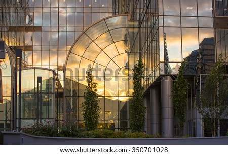 LONDON, UK - 7 SEPTEMBER, 2015: Canary Wharf office's windows lit up at dusk, Business life concept background