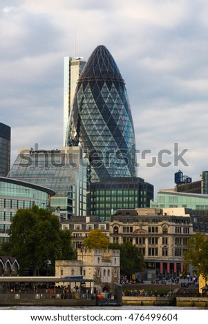 LONDON, UK - SEPTEMBER 19, 2015: City of London skyscraper Gherkin building. View from the embankment at sunset