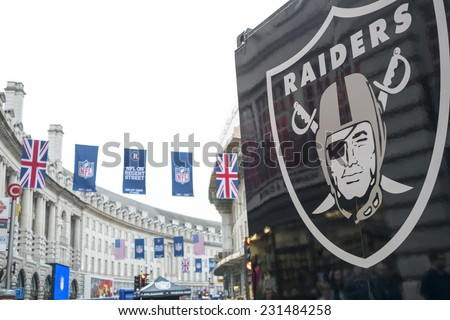 LONDON, UK - SEPTEMBER 27: Detail of Oklahoma Raiders banner and NFL flags above in Regent Street. September 27, 2014 in London. The street was closed to traffic to host NFL related games and events. - stock photo