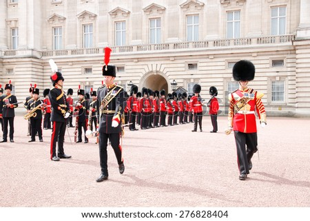 London, UK - September 6 2010 : Honor Guard Marchig during changing of the guard in Buckingham Palace in London, Great Britain - stock photo