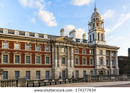 LONDON, UK  SEPTEMBER 1, 2013: Horse Guards building at sunset. It was built 1751 -1753 between Whitehall and Horse Guards Parade in Palladian style by John Vardy and designed by William Kent. - stock photo
