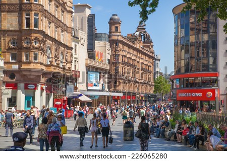 LONDON, UK - SEPTEMBER 30, 2014: Leicester square, popular place with cinemas, cafes and restaurants - stock photo