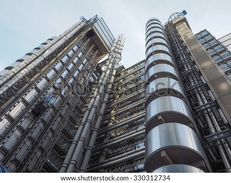 LONDON, UK - SEPTEMBER 29, 2015: Lloyd of London is an iconic high tech skyscraper designed by architect Richard Rogers - stock photo